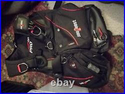 Full Scuba diving kit with BC, drysuit, undersuits, cylinder, regs and extras