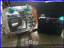 Scuba diving equipment. Drysuit/camera/computer